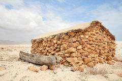 Boat and hut of fisherman on Socotra Island in the Royalty Free Stock Images