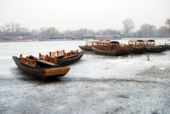 Boat on ice above Stock Photo