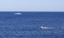 Boat and Iceberg in Gulf of St. Lawrence Royalty Free Stock Photography