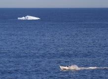Boat and Iceberg at St. Anthony Stock Photo