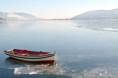 Boat in icy lake. Boat in icy surface of lake stock photography