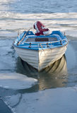 Boat in icy lake Stock Photography