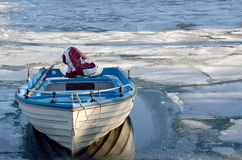 Boat in icy lake Stock Image