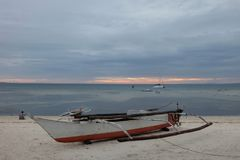 Boat on idyllic beach on island in Phillipines Stock Images