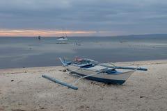 Boat on idyllic beach on island in Phillipines Stock Photos
