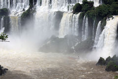 Boat in Iguazu Falls in Argentina. Boat, in Iguazu Falls in Argentina, moving below the waterfall Royalty Free Stock Photography