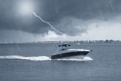 Boat In The Sea Under The Rain Royalty Free Stock Photos