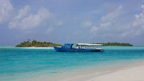The boat in the Indian Ocean. Lonely boat in the Indian Ocean in the background Maldives royalty free stock image