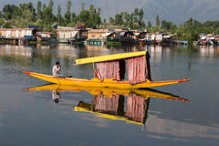 Boat and indian people in Dal lake. Srinagar, India Royalty Free Stock Photos