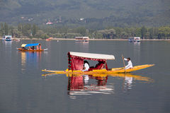 Boat and indian people in Dal lake. Srinagar, India Stock Photography
