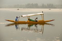 Boat and indian people in Dal lake. Srinagar, Jammu and Kashmir state, India Royalty Free Stock Photo