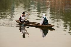Boat and indian people in Dal lake. Srinagar, Jammu and Kashmir state, India Royalty Free Stock Photography