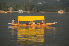 Boat and indian people in Dal lake. Srinagar, Jammu and Kashmir state, India Stock Photos