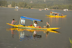 Boat and indian people in Dal lake. Srinagar, Jammu and Kashmir state, India Royalty Free Stock Image