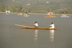 Boat and indian people in Dal lake. Srinagar, Jammu and Kashmir state, India Stock Photography