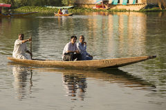 Boat and indian people in Dal lake. Srinagar, Jammu and Kashmir state, India Royalty Free Stock Images