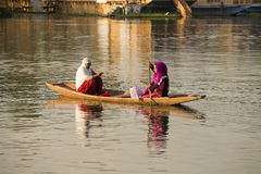 Boat and indian people in Dal lake. Srinagar, Jammu and Kashmir state, India Royalty Free Stock Photos