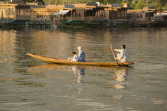 Boat and indian people in Dal lake. Srinagar, Jammu and Kashmir state, India Stock Images
