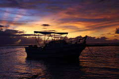 Boat in Indonesia. Sunrise at the ujunggenteng beach royalty free stock photos
