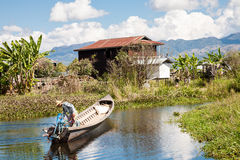 Boat on Inle Lake Canal, Myanmar Royalty Free Stock Photos