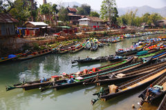 Boat in Inle lake. The slender boat is the typical transportation in Inle Lake, Myanmar stock photo