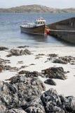 Boat at Iona Harbor, Scotland Royalty Free Stock Image