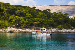 Boat and island in Croatia Stock Photo