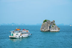 Boat and island in Halong Bay Stock Image