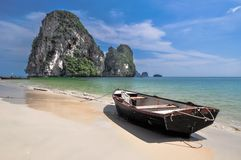 Boat on Island sea sand sun Royalty Free Stock Photos