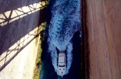 Boat in isthmus. Boat seen from above traveling in Corint isthmus stock photos