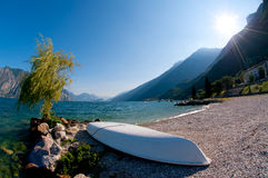 Boat by the italian mountain lake Stock Photos