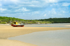 Boat jammed on a beach sandbar after tide go down Royalty Free Stock Image