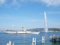Boat & Jet d'eau on Lake Geneva in Switzerland Royalty Free Stock Images