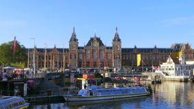 Central Station in Amsterdam, Netherlands. Boat jetty for canal cruises at Central Station, Centraal, Amsterdam, Netherlands, Europe stock video