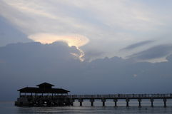 Boat jetty and clouds in Malaysia island Stock Photos