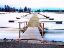 Boat Jetty. A frozen boat jetty Stock Photo