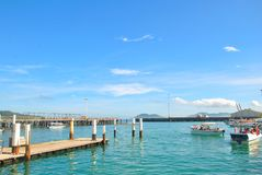 Boat on jetty. SABAH, MALAYSIA - JULY 6, 2017 : The tourist boat is waiting for passengers to be sent to an island Royalty Free Stock Photo