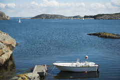 Boat at jetty by the sea. In Swedish west coast archipelago Stock Photos