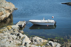 Boat at jetty by the sea. In Swedish west coast archipelago Stock Photo