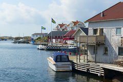 Boat at jetty by the sea. In Swedish west coast archipelago Stock Images