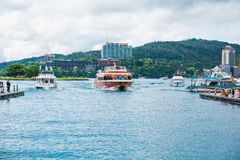 Sun moon lake. A boat just arrived from the Shueishe wharf and fetching tourists to the Xuanguang Temple at Sun Moon Lake stock images