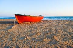 The boat on Kaiafas beach, Greece. The small boat on the deserted sandy Kaifas beach at sunset, Greece stock photos