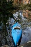 Boat kayak with reflection on water. Merchtem, Belgium. Blue boat kayak with reflection on water. Merchtem, Belgium Royalty Free Stock Image