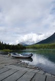 Boat on the Kenai River. A rubber raft awaits passengers for a ride down the river Royalty Free Stock Photography