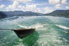 Boat in Kenyir Lake. Small boat pull by parent boat Royalty Free Stock Photos