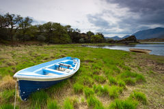 Boat at the Killarney lake Stock Images