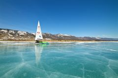 Boat for kitewing frozen ice on a beautiful lake on a background of blue sky Stock Photography