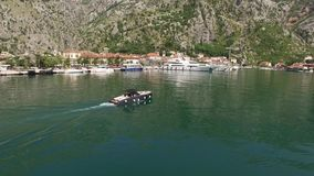 The boat in Kotor, aerial photography drone. Boat dock on the wa. Terfront of the city of Kotor, near the old town. Montenegro stock video