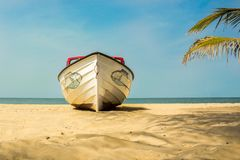 A boat on the beach in The Gambia, West Africa. A boat on Kotu beach in The Gambia, West Africa royalty free stock image