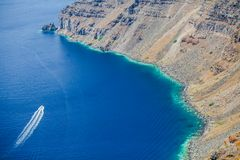 Boat in a lagoon on the island of Santorini,Greece Stock Photos